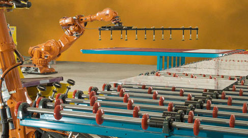 photo of QComp robot handling glass on conveyor