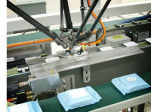 image QComp robotic adhesive system with flexpicker