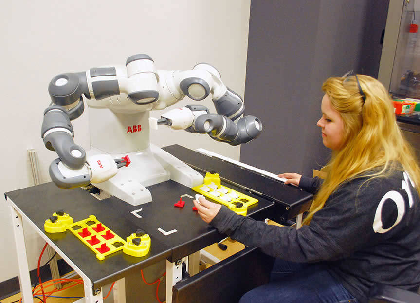 operator interacting with QCOMP YuMi Laboratory Robot